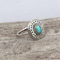 sterling silver ring with turquoise stone detailing