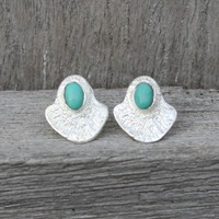 silver plated brass textured studs with a bold bezel and turquoise stone detail