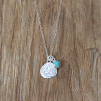 silver 'transition' charm necklace with turquoise stone detail