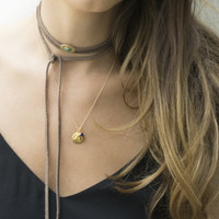gold 'protect' charm necklace with lapis lazuli stone detail