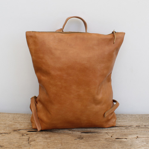 minimalist design caramel leather backpack with top zipper and adjustable straps
