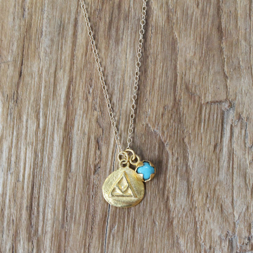gold 'transition' charm necklace with turquoise stone detail