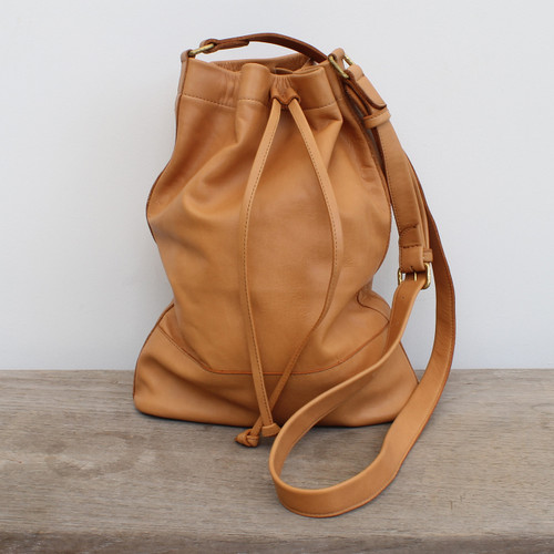 caramel leather handbag with drawstring strap and adjustable straps