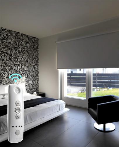 Blackout SOMFY Smart Home Motorized Shades halfway open in bedroom
