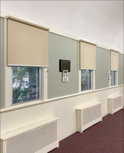 1% Openness Indoor/Outdoor Roll Exposed Cordless Solar Shades in Church Hallway