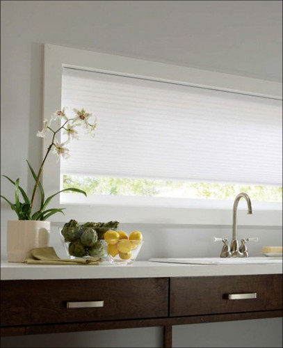 Honeycomb white light-filtering shades in kitchen