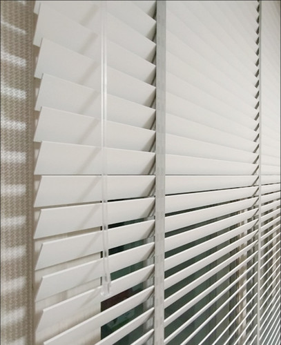 Closed white wood blinds shot