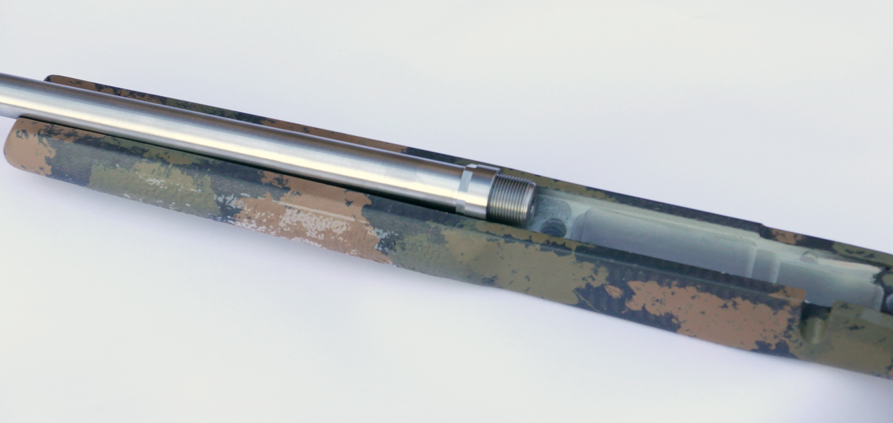 Non-flanged barrel (Ruger American, Ruger Predator, Tikka T3) in a composite stock showing the drop-in fit of the barrel nut in the original barrel channel