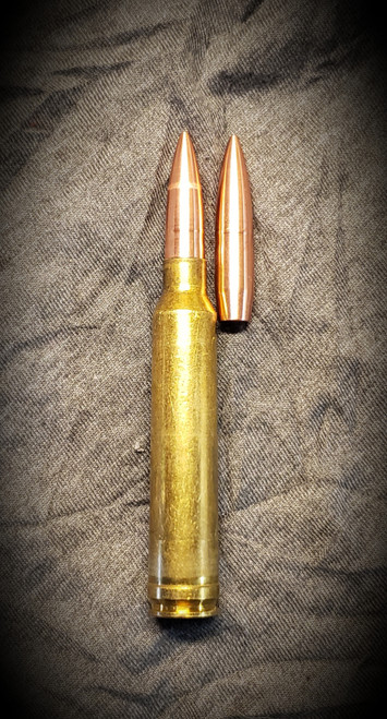 178gr 30 cal shown in 300 Win Mag brass, loaded with boat tail at the base of the neck.  Cartridge OAL is 3.600 as pictured