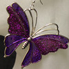 Big butterfly earrings.
