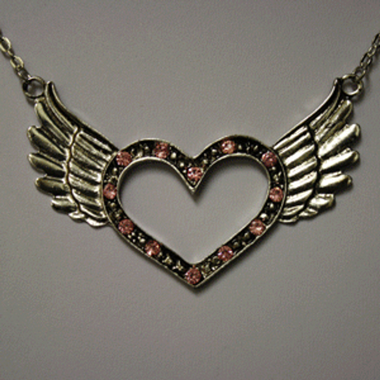 Pink open heart wing necklace