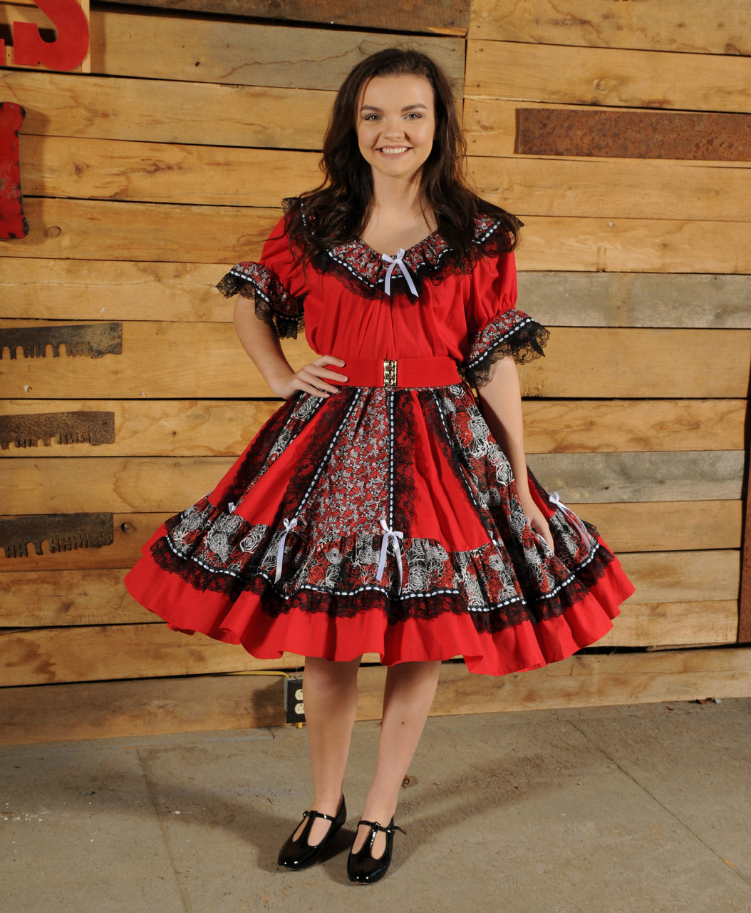 2fb7b3c41df93 2 piece red skirt and blouse. Gored skirt with alternating solid and print  panels trimmed