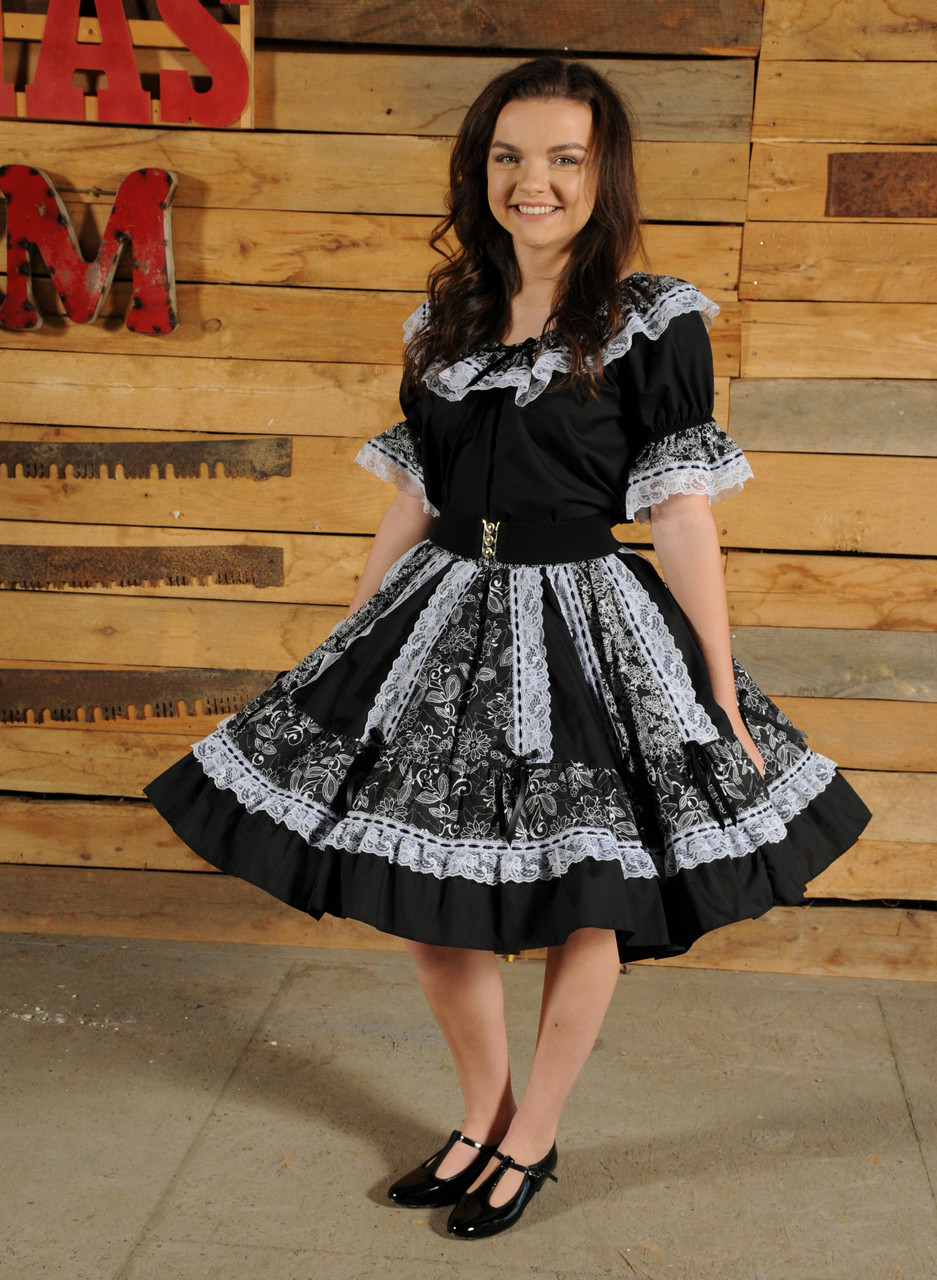 9f07776c41e3d 2 piece black skirt and blouse. Gored skirt with alternating solid and print  panels trimmed