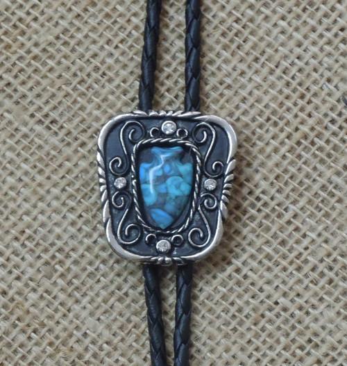 8e6b5fcf642f Semi-square bolo with arrowhead shaped turquoise stone in the center. A  rhinestone on
