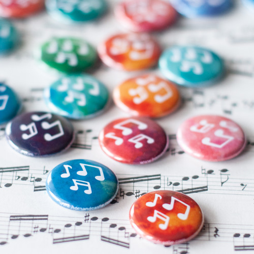 Music note buttons on a watercolor background