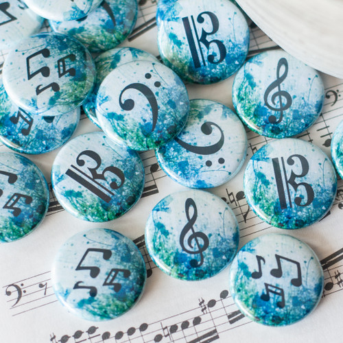 Treble, alto, or bass clef buttons with a blue floral background.