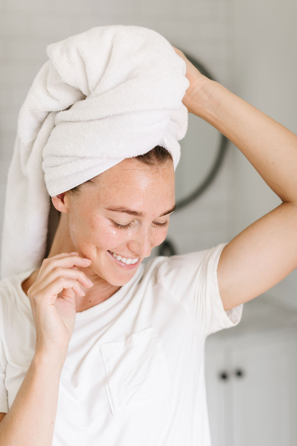 woman smiling with a towel wrapped around her head