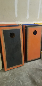 Refurbished - Orange And Black Alternating Rosewood Border Cornhole Boards