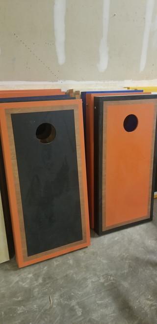 Refurbished - Orange And Black Alternating Rosewood Border Cornhole Boards