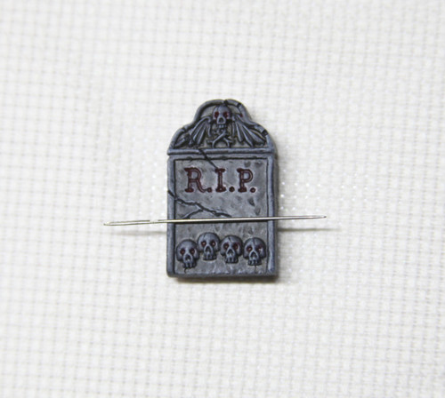 Tombstone needle minder hand painted