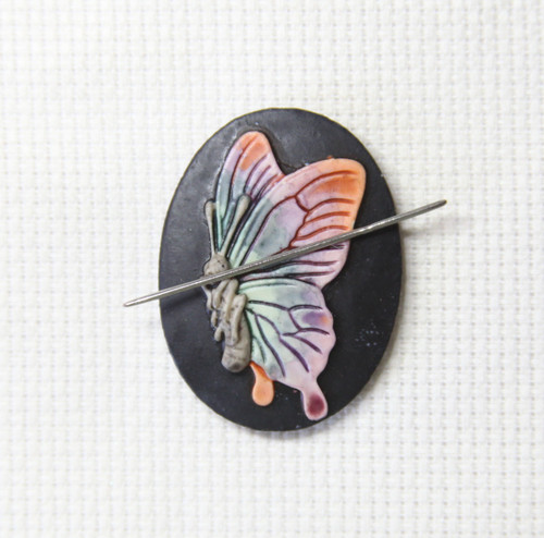 Butterfly hand painted needle minder