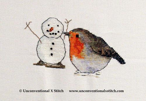 Robin Builds a Snowman cross stitch pattern