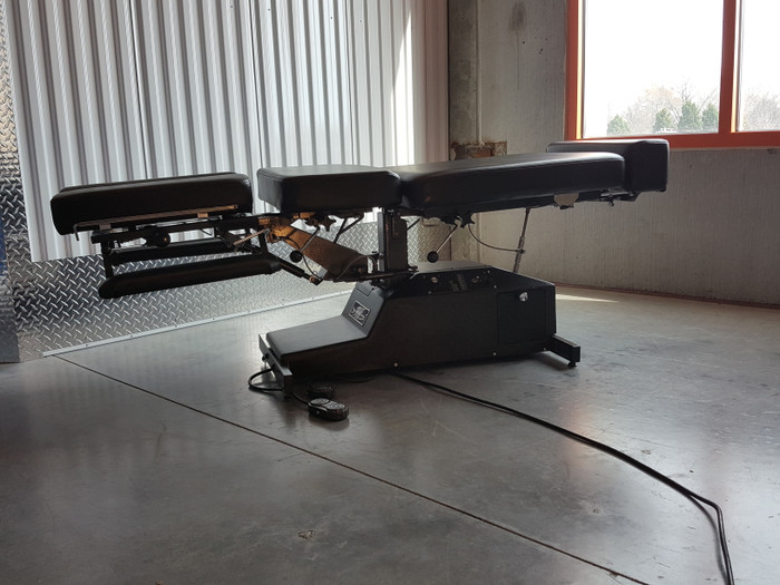 Used Leander Auto Flexion with drops and breakaway Used Chiropractic table