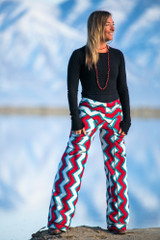 Eco fashion designer Autumn Teneyl wearing wide legged pants with a boho red design.