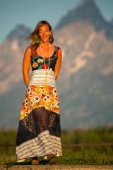 Fashion Design Autumn Teneyl wearing a long boho dress on a mountain