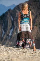 American Fashion Designer wearing a beautiful boho long dress in the Teton Mountains of Utah.