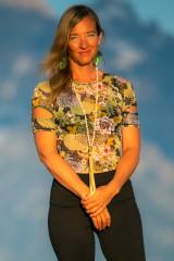 Fashion Designer Autumn Teneyl wearing a short sleeved top in the Teton Mountains of Wyoming.