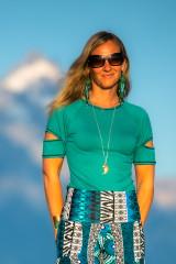 Fashion designer Autumn Teneyl wearing a teal short sleeved top in the Teton Mountains in Wyoming.