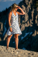 Fashion designer Autumn Warner wearing a boho style dress on top of a mountain in California
