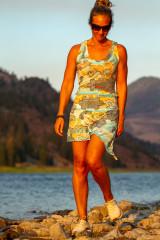 Fashion designer Autumn Teneyl wearing a boho top by a lake