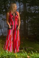 Fashion designer Autumn Teneyl wearing a boho style striped jumpsuit.