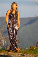 American Fashion Designer Autumn Teneyl wearing a tie dye boho one piece jumpsuit in the North Carolina mountains.