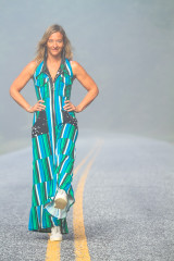 American Fashion Designer Autumn Teneyl looking super cute wearing a boho style striped one piece jumpsuit handmade from aqua fabric