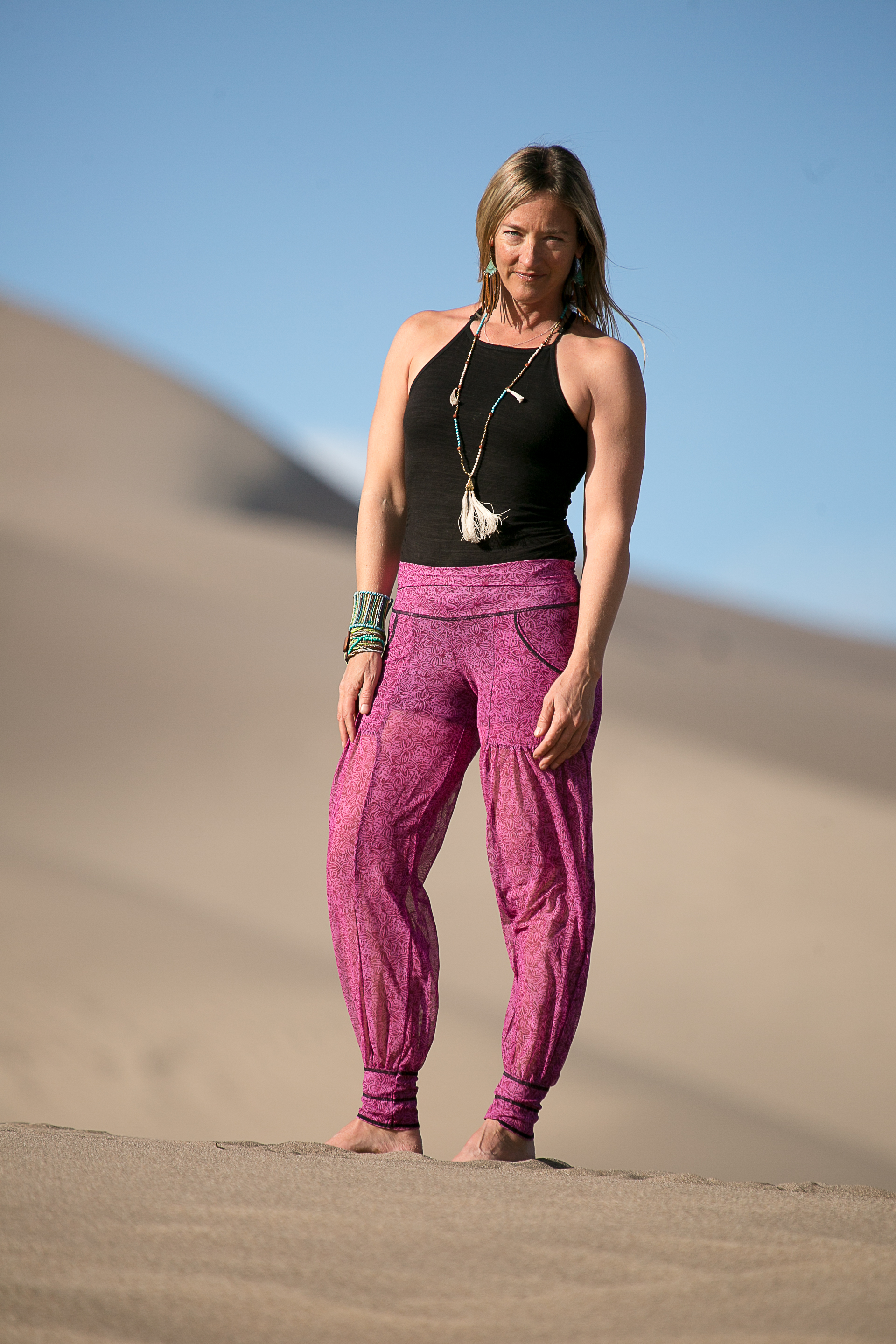 """Cool mesh fabric conceived for the beach or resort wick drys and silky to the touch. Our newest and dare we say """" Our Best"""" addition to the Autumn Teneyl Line.  This pant was made for everybody!  It has the comfy, casual vibe but can handle a night on the town with the right pair of shoes! We constructed it with a pull on waist for a great fit and added comfort. Two front pockets pocket for style and a hidden pocket to keep your valuables safe. Who doesn't love pockets! You can push the cuff up and wear the leg as a cropped pant."""