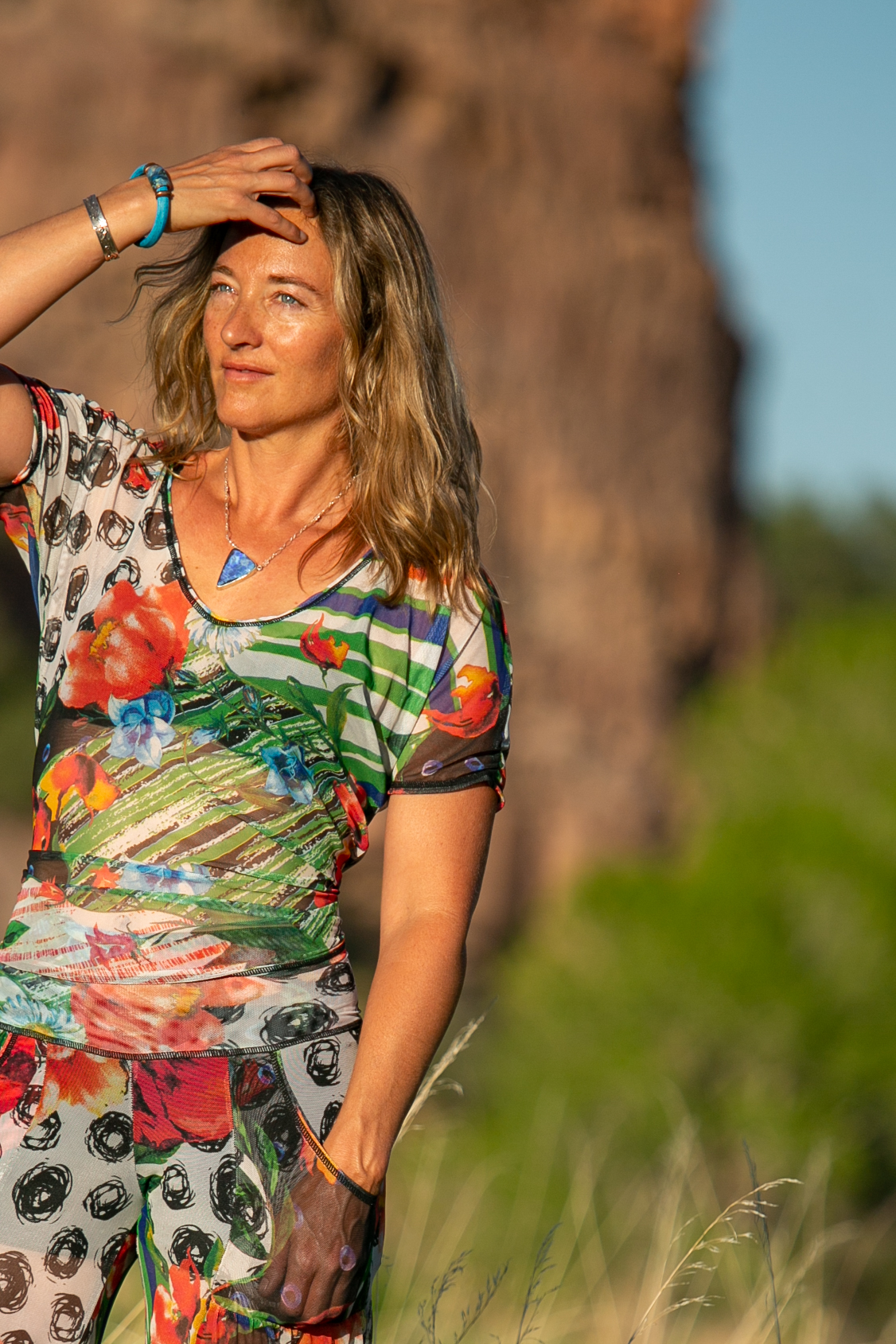 One Top but so many options!  The Sunset is so versatile you will wear over and over in so many different looks. Can be worn with the V-neck in the front or in the back and its perfect for layering be it over or under other pieces for a complete look. We love it with the Warrior Tank. So popular that we made in an assortment of fabrics because you'll want more than one!