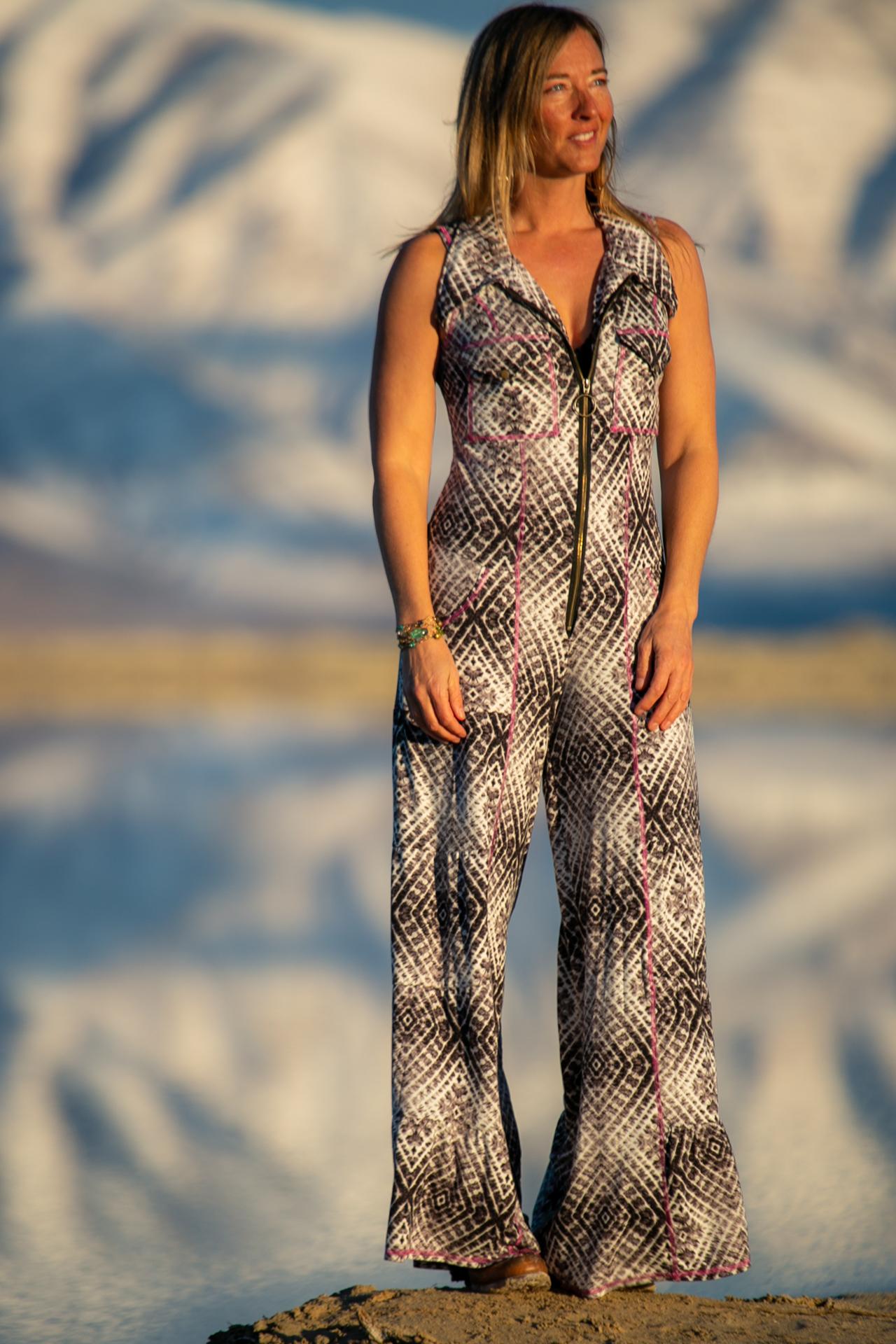 American Fashion Designer Autumn Teneyl looking super cute wearing a boho style tie dye one piece jumpsuit handmade in Colorado.
