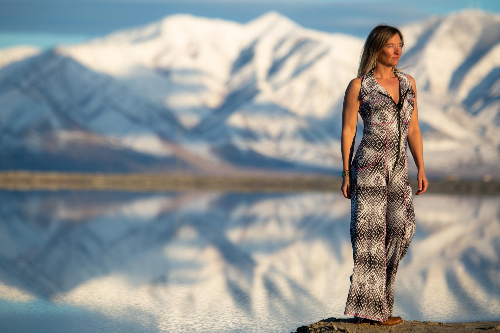 Fashion Designer Autumn Teneyl looking boho chic wearing a tie dye onesie handmade in Colorado.