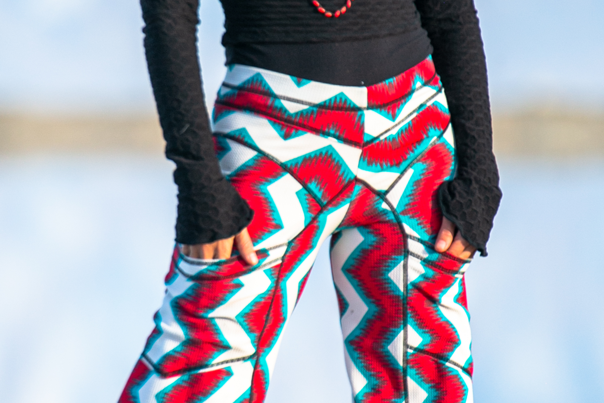 Eco fashion designer Autumn Teneyl wearing wide legged pants with a boho red design