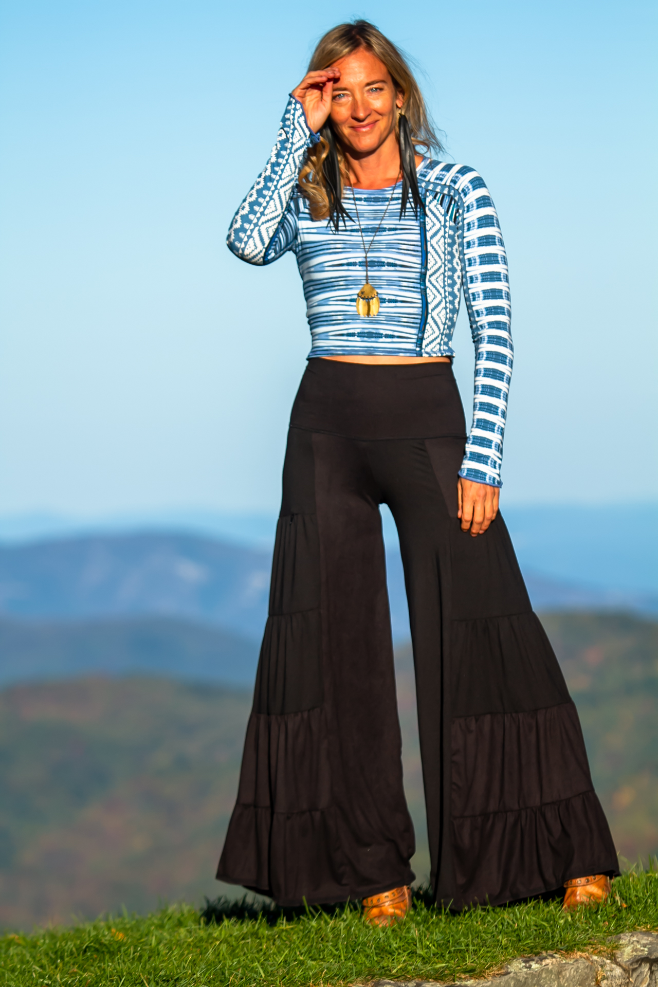Fashion Design Autumn Teneyl wearing a boho look by Autumn Teneyl Designs featuring a Wide legged black pant with a crop top.