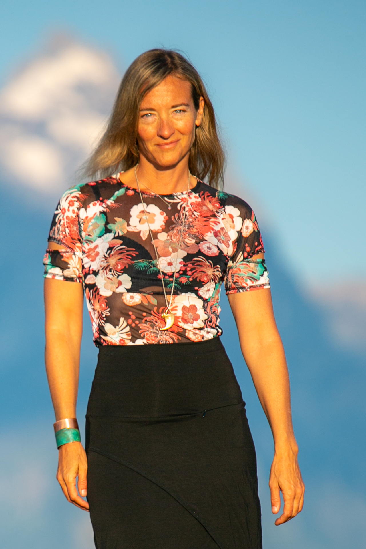 Fashion designer Autumn Teneyl wearing her newest designed short sleeved top in the Teton Mountains in Wyoming.