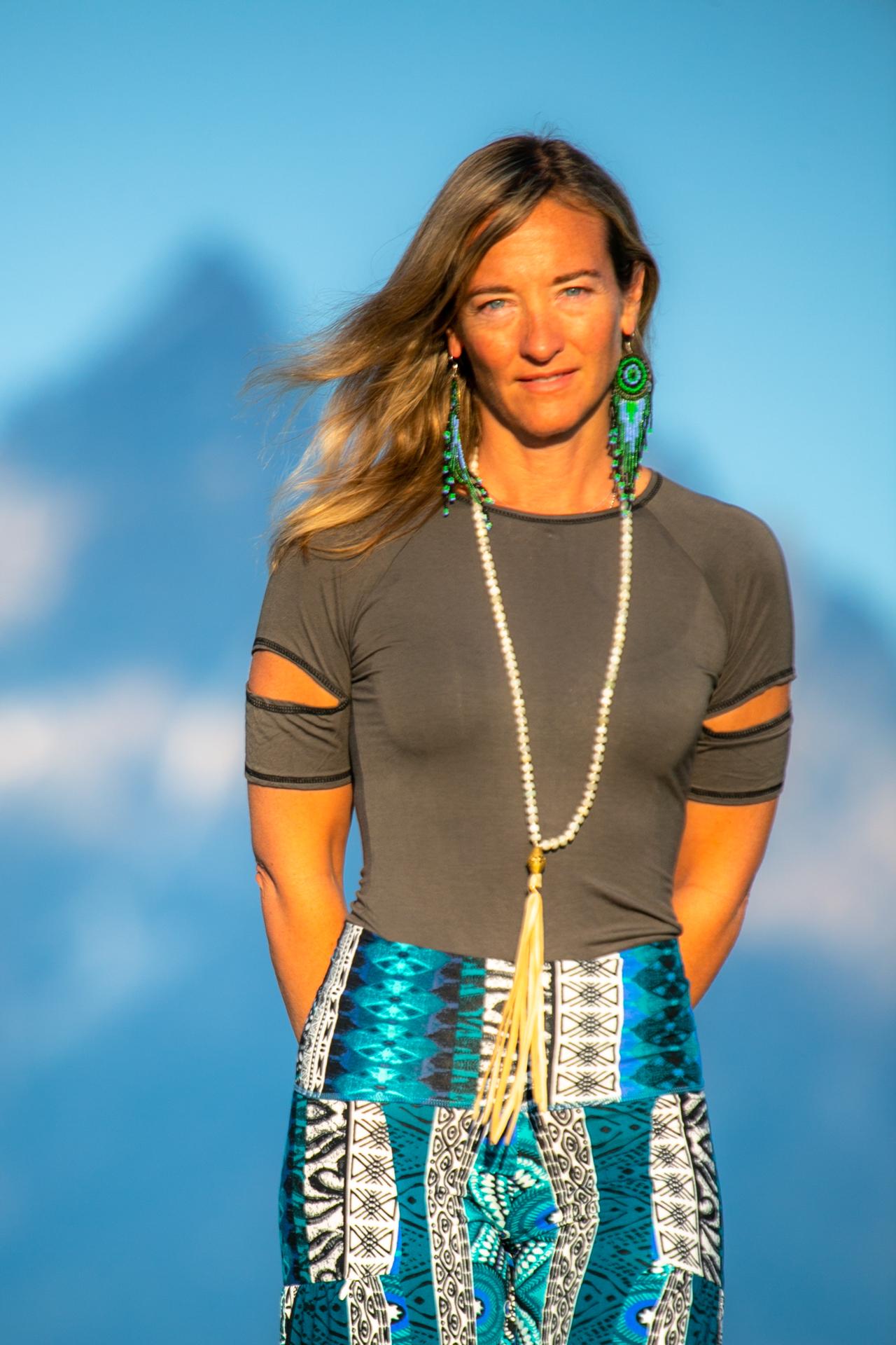 Fashion designer Autumn Teneyl wearing a short sleeved top in the Teton Mountains in Wyoming.
