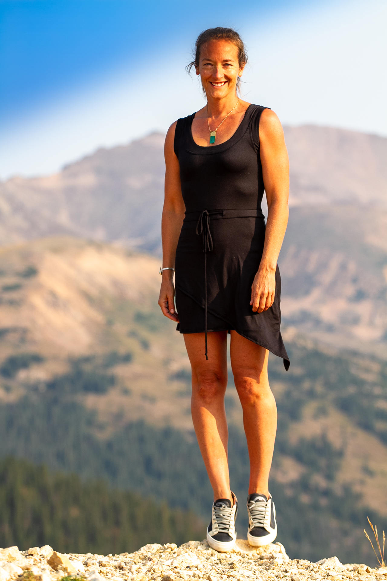 Fashion Design Autumn Warner wearing a cute black tennis dress with pockets