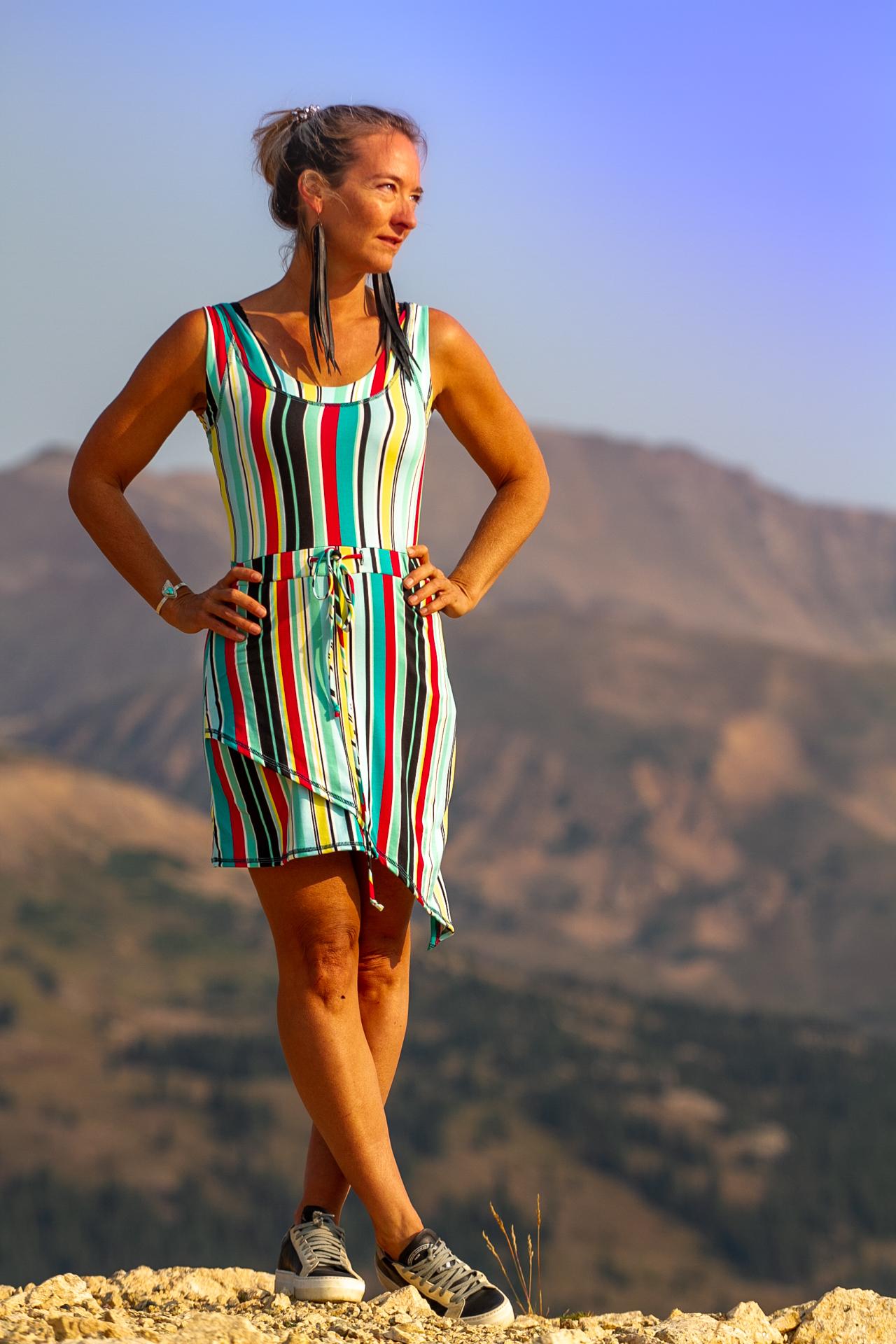 Fashion Designer Autumn Teneyl wearing  striped boho dress in the mountains