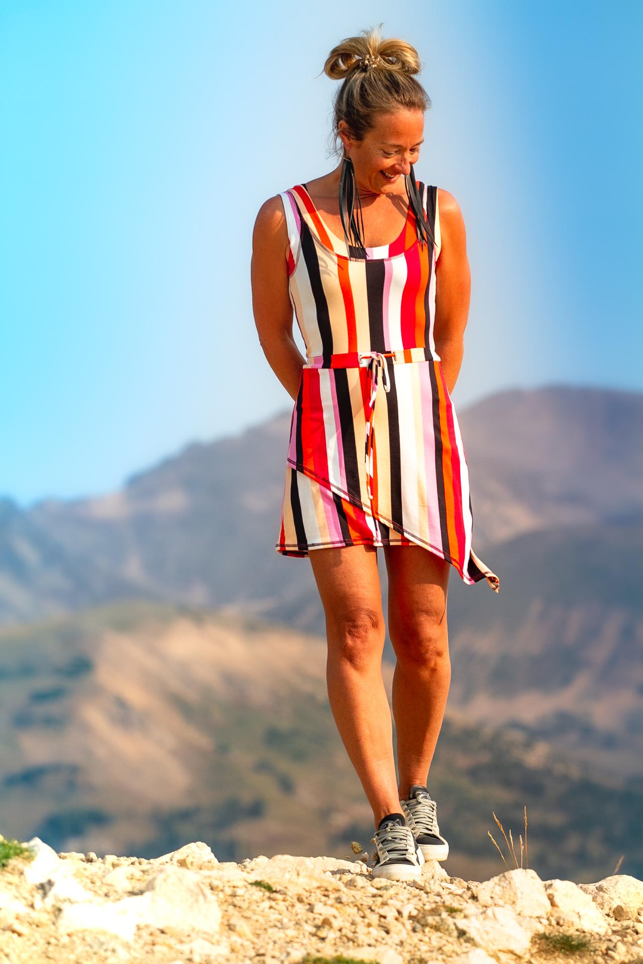 Fashion Designer Autumn Warner wearing a pockets mini dress With striped