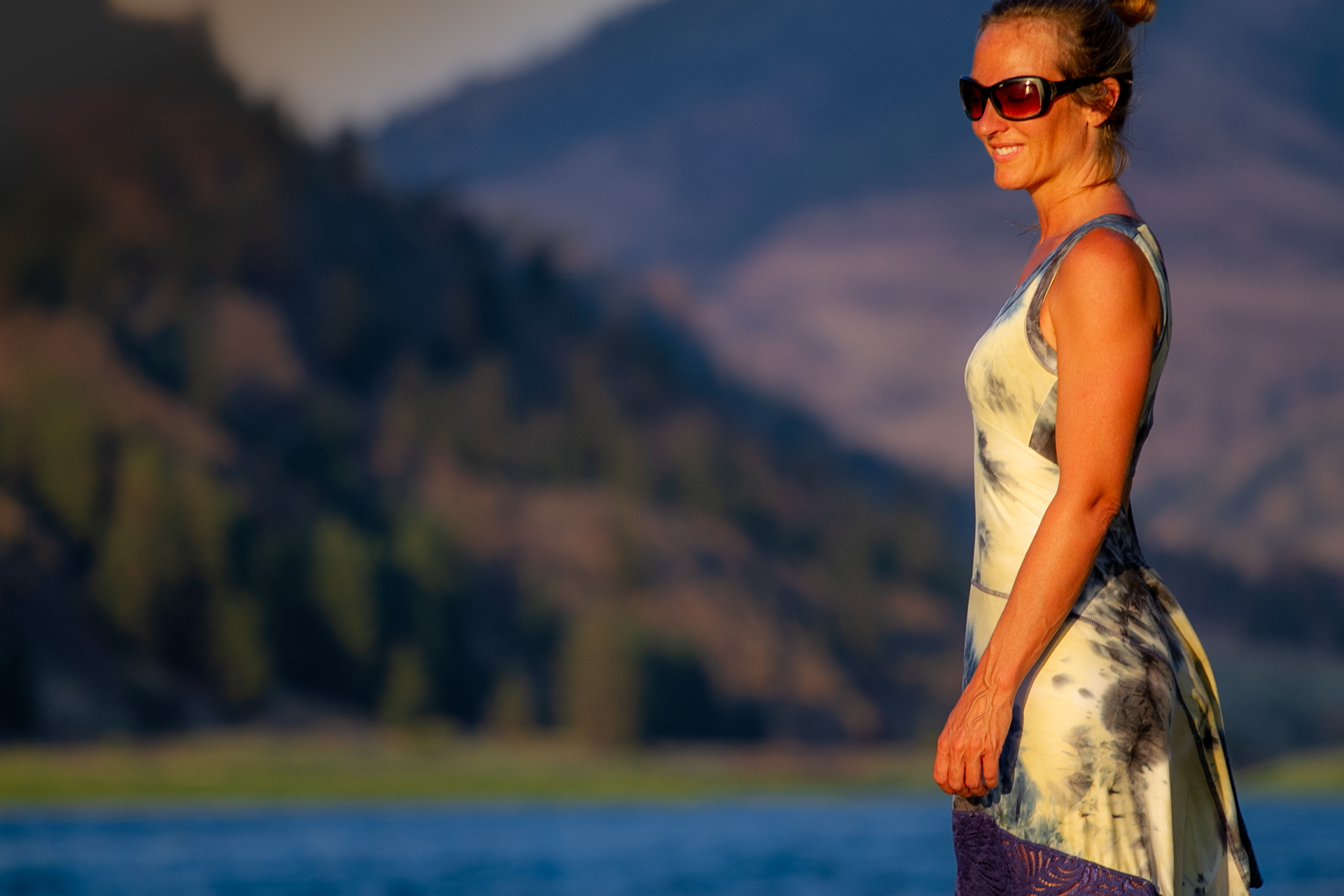 Fashion Designer Autumn Teneyl wearing a boho dress in the mountains.