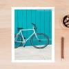 Blue Cycle on Beach Canvas Print